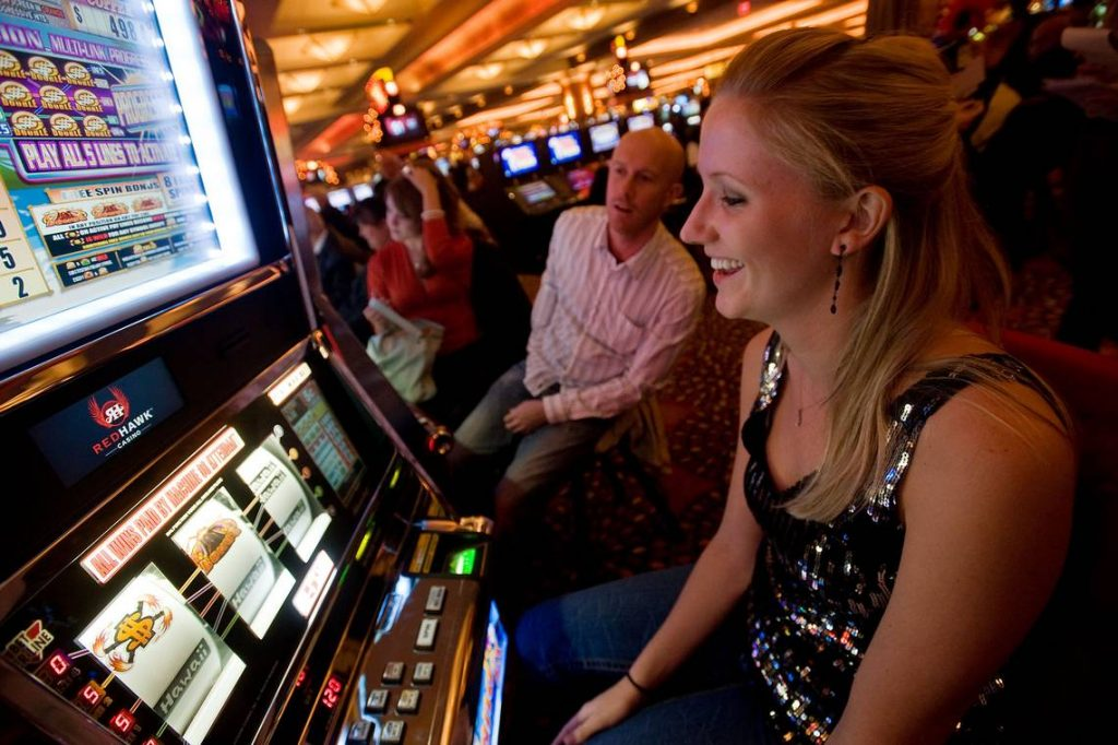 Why do people choose to play online slots compared to a physical casino?